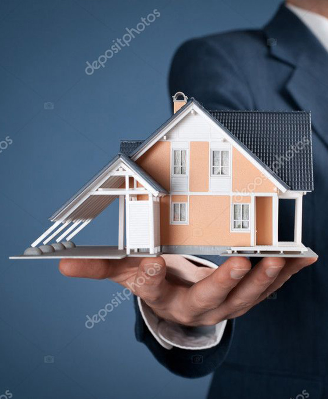 Gray Appraisals - Agent holding model of house